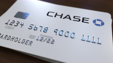 bankomat : Plastic card with logo of the Chase Bank. Editorial conceptual 3D animation