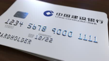 fraudulent : Plastic card with logo of China Construction Bank. Editorial conceptual 3D animation