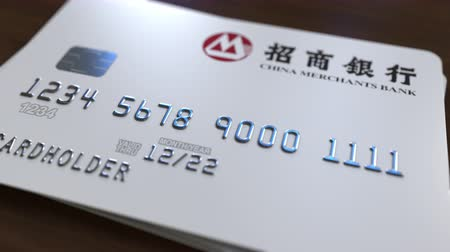 bankomat : Plastic card with logo of China Merchants Bank. Editorial conceptual 3D animation
