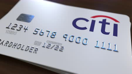 bankomat : Plastic bank card with logo of Citibank. Editorial conceptual 3D animation Wideo