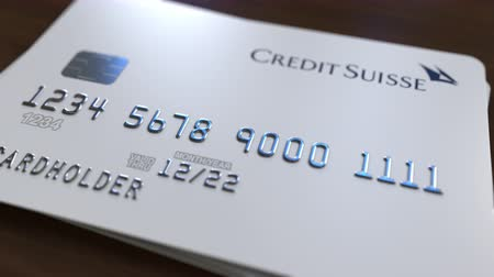 bankomat : Plastic bank card with logo of Credit Suisse. Editorial conceptual 3D animation Wideo