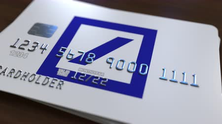 bankomat : Plastic card with logo of Deutsche Bank DB. Editorial conceptual 3D animation Wideo