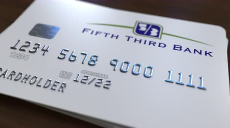 bankomat : Plastic card with logo of the Fifth Third Bank. Editorial conceptual 3D animation
