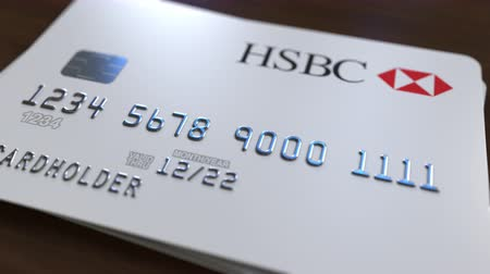 fraudulent : Plastic bank card with logo of HSBC. Editorial conceptual 3D animation Stock Footage
