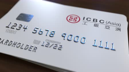 fraudulent : Plastic card with logo of Industrial and Commercial Bank of China ICBC. Editorial conceptual 3D animation Stock Footage