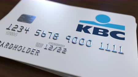 bankomat : Plastic card with logo of KBC Bank. Editorial conceptual 3D animation Wideo
