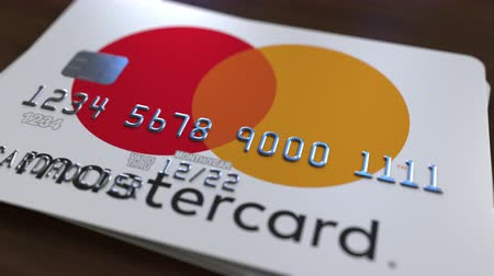 bankomat : Plastic card with logo of Mastercard. Editorial conceptual 3D animation