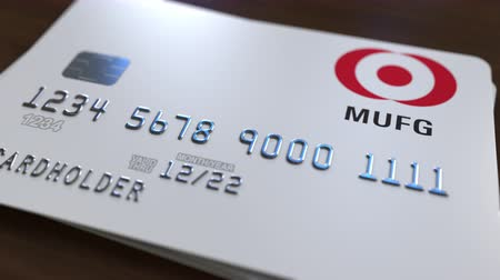 fraudulent : Plastic bank card with logo of Mitsubishi UFJ. Editorial conceptual 3D animation Stock Footage