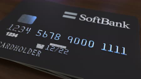fraudulent : Plastic card with logo of SoftBank. Editorial conceptual 3D animation