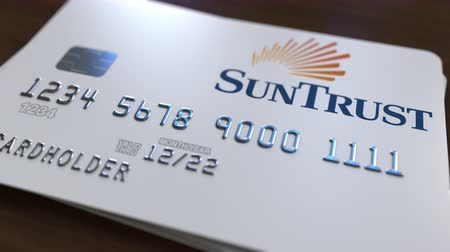 fraudulent : Plastic bank card with logo of SunTrust Bank. Editorial conceptual 3D animation