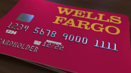 fraudulent : Plastic bank card with logo of Wells Fargo. Editorial conceptual 3D animation Stock Footage