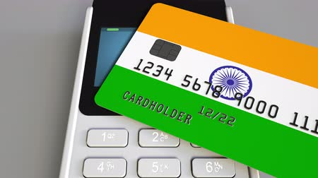 payment terminal : Payment or POS terminal with credit card featuring flag of India. Indian retail commerce or banking system conceptual animation Stock Footage