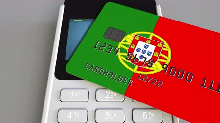 payment terminal : Payment or POS terminal with credit card featuring flag of Portugal. Portuguese retail commerce or banking system conceptual animation