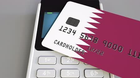 payment terminal : Payment or POS terminal with credit card featuring flag of Qatar. Qatari retail commerce or banking system conceptual animation Stock Footage