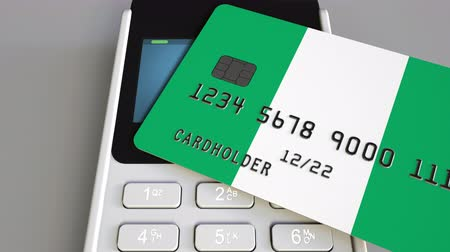payment terminal : Payment or POS terminal with credit card featuring flag of Nigeria. Nigerian retail commerce or banking system conceptual animation Stock Footage