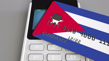 sell : Payment or POS terminal with credit card featuring flag of Cuba. Cuban retail commerce or banking system conceptual animation Stock Footage