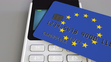 eur : Payment or POS terminal with credit card featuring flag of the European Union. EU retail commerce or banking system conceptual animation Dostupné videozáznamy