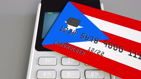 debit : Payment or POS terminal with credit card featuring flag of Puerto Rico. Retail commerce or banking system conceptual animation