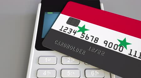 payment terminal : Payment or POS terminal with credit card featuring flag of Syria. Syrian retail commerce or banking system conceptual animation Stock Footage
