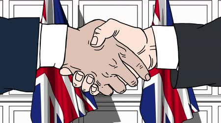 working together : Businessmen or politicians shaking hands against flags of Great Britain. Meeting or cooperation related cartoon animation Stock Footage