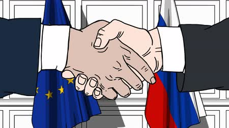 treaty : Businessmen or politicians shaking hands against flags of EU and Russia. Meeting or cooperation related cartoon animation Stock Footage