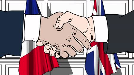treaty : Businessmen or politicians shaking hands against flags of France and Great Britain. Meeting or cooperation related cartoon animation
