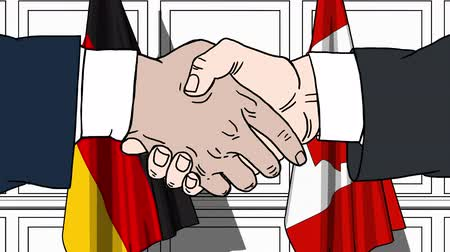 comics : Businessmen or politicians shaking hands against flags of Germany and Canada. Meeting or cooperation related cartoon animation Stock Footage