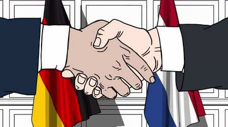 treaty : Businessmen or politicians shaking hands against flags of Germany and Netherlands. Meeting or cooperation related cartoon animation Stock Footage