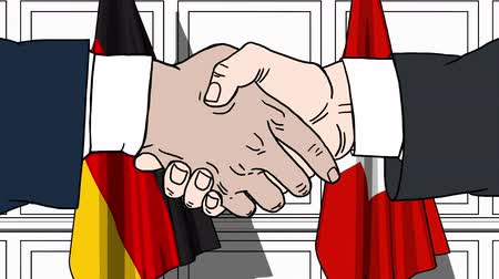 autoridade : Businessmen or politicians shaking hands against flags of Germany and Switzerland. Meeting or cooperation related cartoon animation