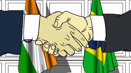 brazil : Businessmen or politicians shaking hands against flags of India and Brazil. Meeting or cooperation related cartoon animation