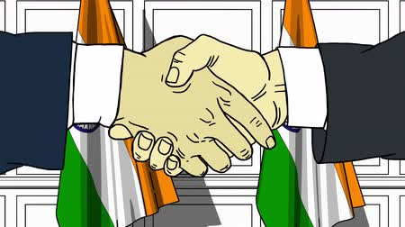 treaty : Businessmen or politicians shaking hands against flags of India. Meeting or cooperation related cartoon animation