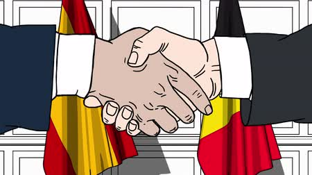belga : Businessmen or politicians shake hands against flags of Spain and Belgium. Official meeting or cooperation related cartoon animation