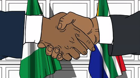 nigeria : Businessmen or politicians shake hands against flags of Nigeria and South Africa. Official meeting or cooperation related cartoon animation