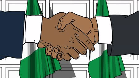 nigeria : Businessmen or politicians shake hands against flags of Nigeria. Official meeting or cooperation related cartoon animation