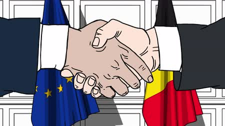 belga : Businessmen or politicians shake hands against flags of European Union EU and Belgium. Official meeting or cooperation related cartoon animation Vídeos