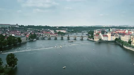 escala : Aerial view of crowded famous Charles Bridge in Prague and Vltava riverbanks, the Czech Republic