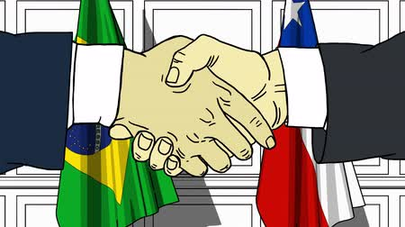brazil : Businessmen or politicians shake hands against flags of Brazil and Chile. Official meeting or cooperation related cartoon animation Stock mozgókép