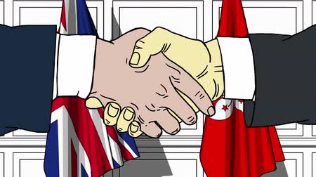 colaboração : Businessmen or politicians shake hands against flags of Britain and Hong Kong. Official meeting or cooperation related cartoon animation