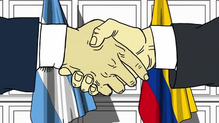 Колумбия : Businessmen or politicians shake hands against flags of Argentina and Colombia. Official meeting or cooperation related cartoon animation