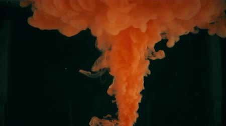 выброс : Eruption of orange liquid. Science related shot