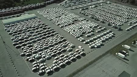 kötet : Aerial shot of a car manufacturer parking