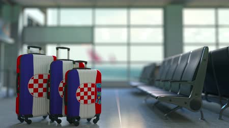 chorvatský : Travel suitcases featuring flag of Croatia. Croatian tourism conceptual animation
