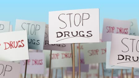 picketing : STOP DRUGS placards at street demonstration. Conceptual loopable animation
