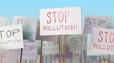 gösterici : STOP POLLUTION placards at street demonstration. Conceptual loopable animation