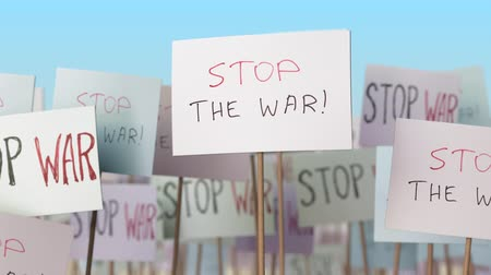 gösterici : STOP WAR placards at street demonstration. Conceptual loopable animation