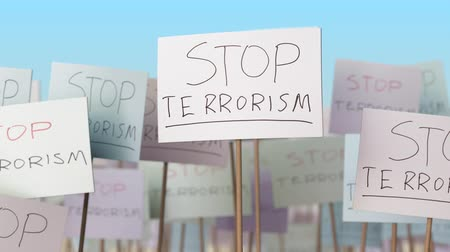 picketing : STOP TERRORISM placards at street demonstration. Conceptual loopable animation