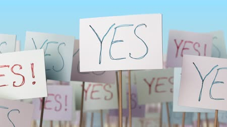 picketing : YES placards at street demonstration. Conceptual loopable animation