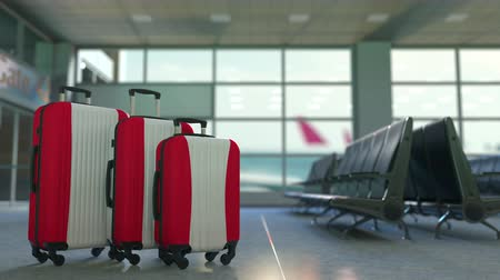 awaiting : Travel suitcases featuring flag of Austria. Austrian tourism conceptual animation Stock Footage