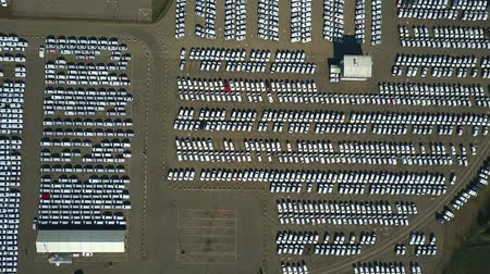 gyártó : High altitude aerial top down view of a car manufacturer warehouse Stock mozgókép