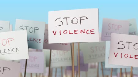cruelty : STOP VIOLENCE placards at street demonstration. Conceptual loopable animation Stock Footage
